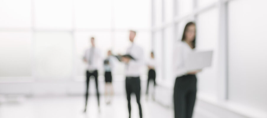 blurred image of business people standing in the office lobby .business background